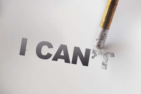 I can't to I can Changing phrase words with a pencil eraser. Self motivation startup concept.