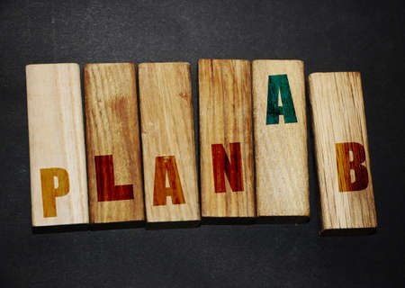 Plan A to plan B on wooden blocks. Business planning economics investment concept.