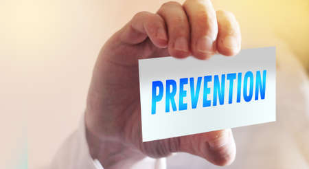 Prevention text on card and hand holding it. Healthcare or prevention concept. Banque d'images