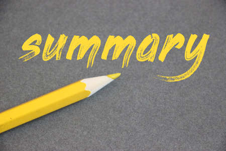 Summary word hand written in yellow letters with pencil besides on grey background. Business photo Brief Statement Abstract Synopsis Concise concept. Imagens