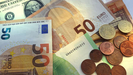Fifty and hundred euro bills and coins. Money finance concept..