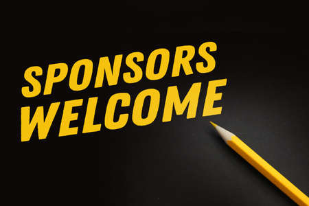 Word SPONSOR WELCOME written on a blackboard with yellow pencil. Fundrising financing sponsorship concept.