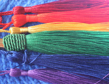 LGBT flag colors multicolor party tassels. Gay and background concept.