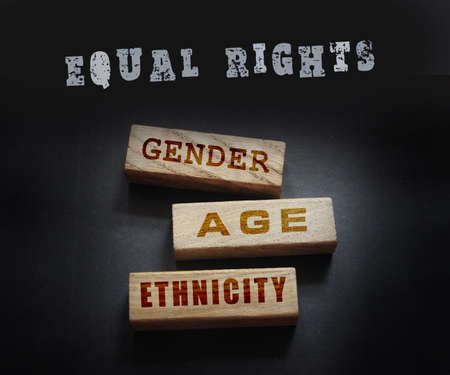 Gender age ethnicity words on wooden blocks. Equality equal rights concept.
