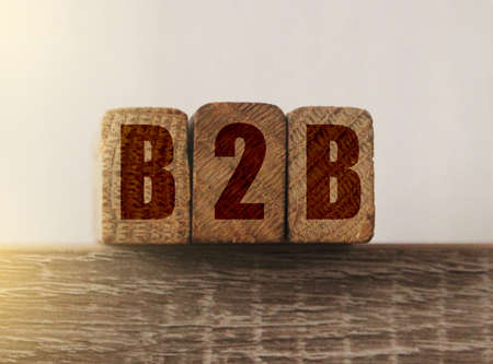 B2B on wooden blocks. Business-to-business or back-to-back concept. Banco de Imagens