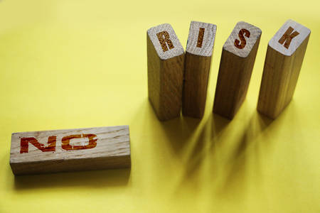 No risk wotds on wooden blocks. Investment risky assets financial instruments concept,