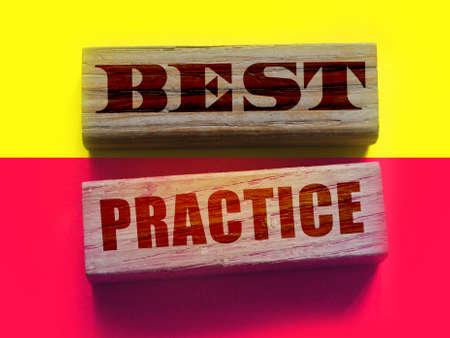 Best practice words on Wooden Blocks. Education practicing repeatition concept, business startup cpncept.