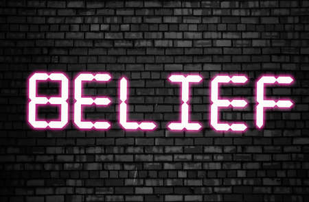 Belief word glowing in neon pink on black brick wall. Believes and statements, personal coaching and achievements concept.