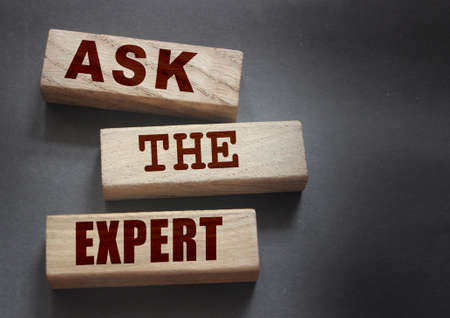 Ask the Expert words on wooden blocks. Consulting a professional, master or consultant for a solution and advice business concept.