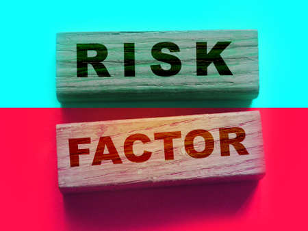Risk factor words on wooden blocks. Healthcare or business startup causes of failure concept.