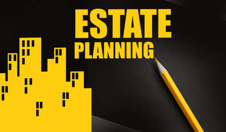 Estate planing and yellow pencil on dark background. Real estate business concept. Stock Photo