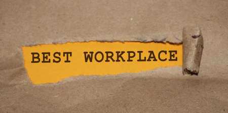 Best Workplace words appearing under brown torn paper. HR human resources management in successfull business concept. Stock Photo