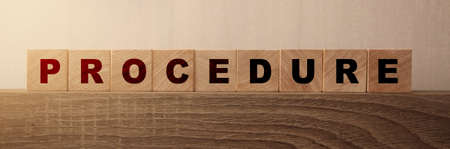 Procedure word written on wood block. Policy text on wooden cubes. Medical or legal concept.