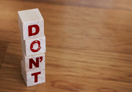 Don't words on wooden blocks arrange vertically with copyspace for motivational concept.