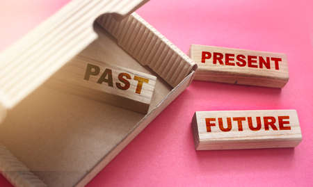 Past Present Future words on Wooden Blocks in the box and outside. The value of time concept. Positive mindset concept. Archivio Fotografico