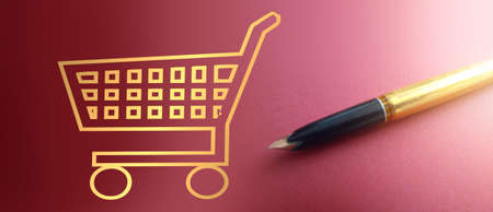 Shopping cart symbol in gold and luxury pen on deep pink gradient.