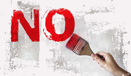 No word in red and paintbrush on white grey background. Refuce tolerance concept. 免版税图像