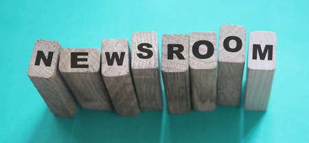 NEWSROOM word made with wooden building blocks. Фото со стока