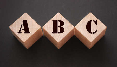 ABC Three wooden cubes with letters. Back to basics elementary school concept. Фото со стока - 147267200