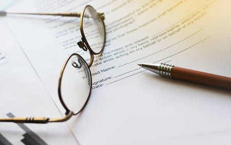 Agreement with pen and glasses. Selective focus. Business work office career concept.
