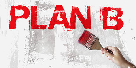 Plan B words in red and brush in hand on grundge white grey background. Crisis management business concept..