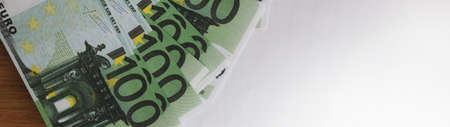 100 Euro banknotes and white copyspace wide banner. Money spending, saving and invest.ment concept.