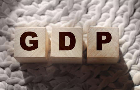 GDP, Gross Domestic Product concept, cube wooden block with alphabet combine abbreviation GDP, measure growth of country economic product and service.