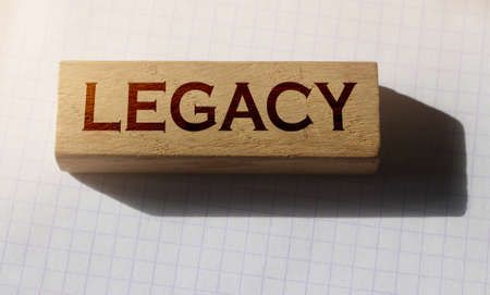 Word Legacy on Wooden building cubes with letters. Law business concept.