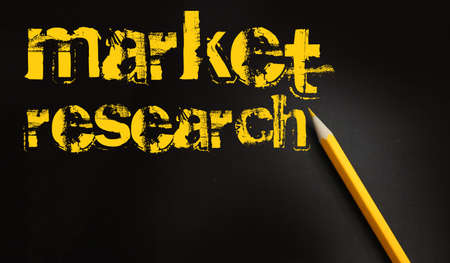 Market research words and yellow pencil on black background. Marketing and management Business strategy planning concept.