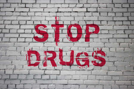 Stop Drugs words on Brick Wall Addiction awareness, Say No to Substances Abuse concept. Motivational call written on the wall.