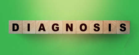 DIAGNOSIS - words from wooden blocks with letters on green background. Healthcare, feel worried and nervous stress concept.