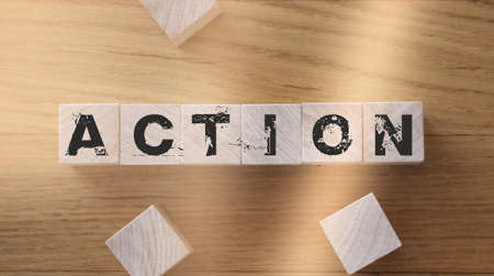 Wooden Blocks with the text: Action. Business and Education concept.
