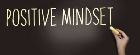 Positive Mindset handwritten with white chalk on a blackboard. Think positively lifestyle state of mind psychological concept. Zdjęcie Seryjne