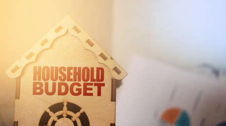 Wooden toy house with words Household Planning. ,Financial planning concept. Stock Photo
