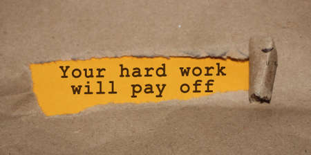 The text Your hard work will pay off appearing behind torn brown paper. Business startup devepolment or career concept.