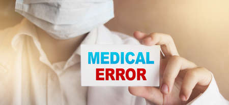 Doctor holding a card with Medical Error, Medical concept. Stock Photo