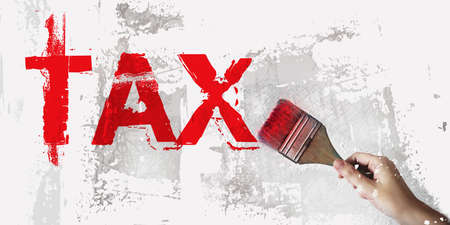 Red word TAX written with paintbrush. Taxes and fees financial business concept. 版權商用圖片