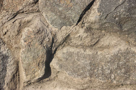 Grunge texturized natural stone wall exterior,background .