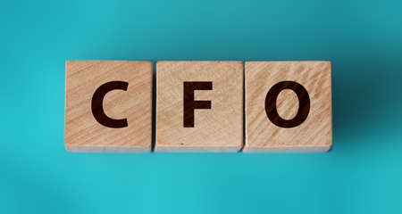 CFO texton wooden cubes. Chief Financial Officer on table background. Financial, marketing and business leader concept. Foto de archivo - 150386505