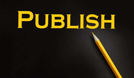 Publish word printed in yellow on black paper. Publishing business concept.