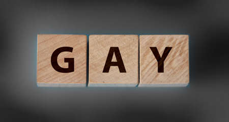 Gay word from wooden blocks on desk