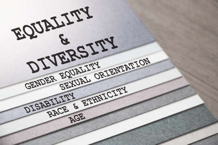 Equality and Diversity gender sexual orientation ethnicity disability age words on pages of copybook . Social concept Stockfoto