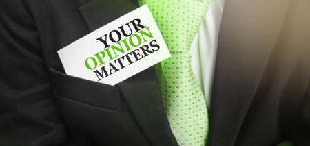 Businessman putting card Your Opinion Matter in pocket. Teamwork Concept Stockfoto