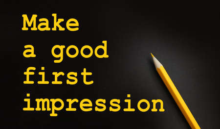 Make a Good First Impression text on black and yellow pencil. Career concept.