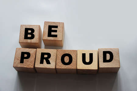 Be proud text on wooden cubes equal right pride concept. Awards achievements and being proud of them. Banque d'images