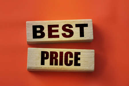 best price words on wooden blocks on red. Big sale grand opening business concept. Banque d'images