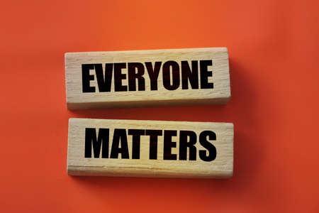 Everyone matters - phrase words from wooden blocks with letters, accepting others individuality everyone matters concept, top view gray background.