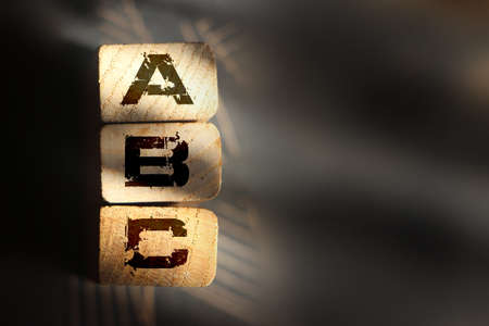 ABC wooden blocks stacked vertically .. Elementary school education concept. Basics concept. Banco de Imagens