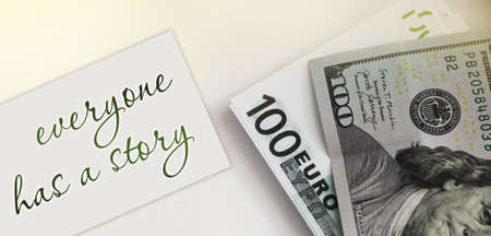 Note Everyone has story and money banknotes. Business case study concept. 100 Euro and 100 dollars. Stok Fotoğraf