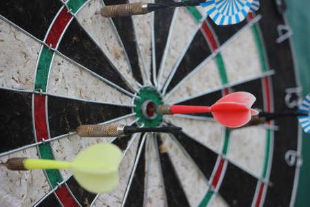 Darts target closeup. Success hitting target aim goal achievement concept.